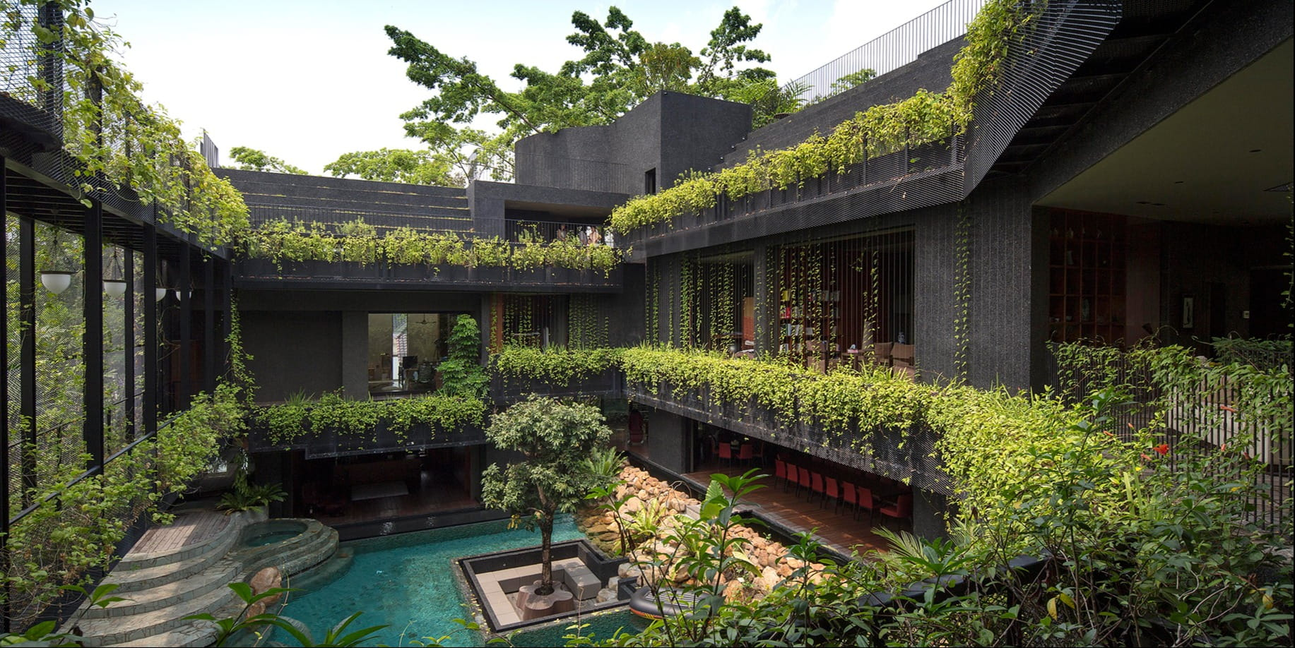 This house in Singapore features a bio pool and a cascading garden, appearing as a green oasis