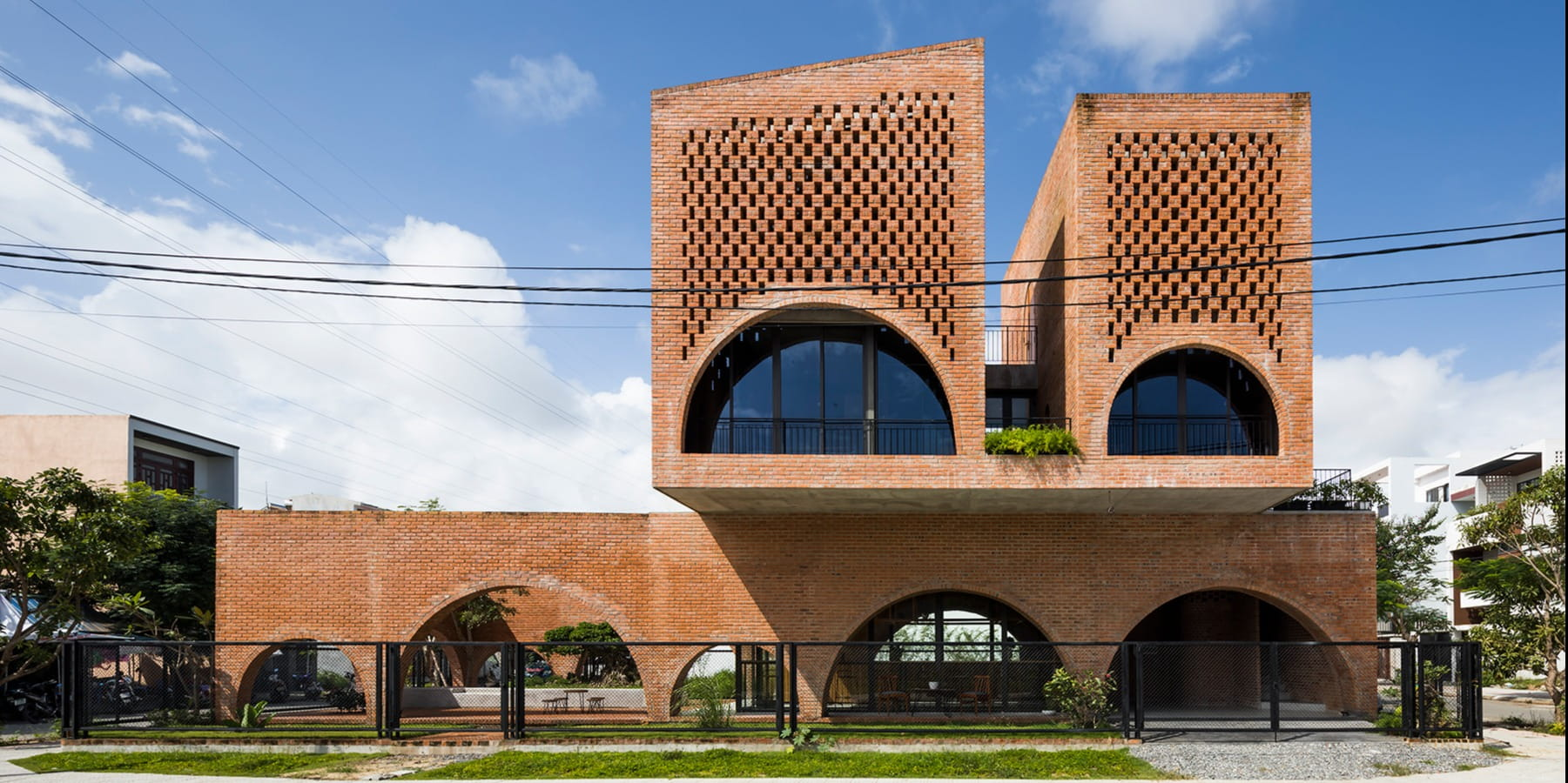 Tropical Space designed Cuckoo House duals as a coffee shop and a family home, wrapped in tapestry of bricks