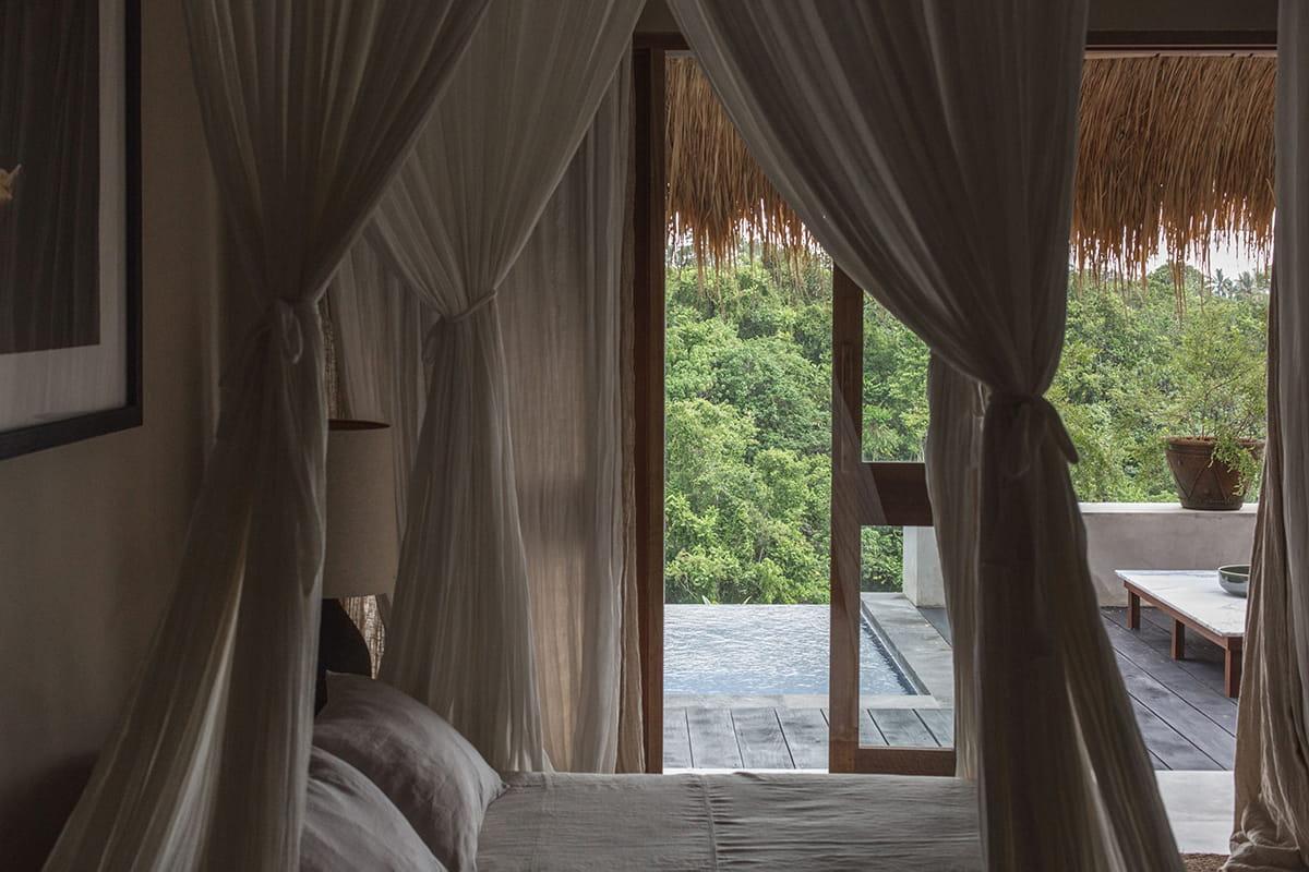 Bedroom with view of pool at Rumah Purnama